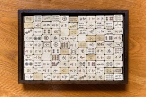 mahjong board game pieces asians use to stay mentally sharp at home with family | luxury homes by brittany corporation