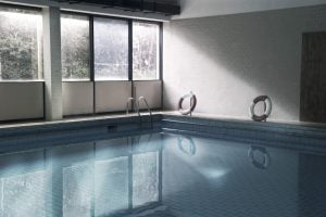 empty Swimming pool in a luxury home   Luxury Homes by Brittany corporation