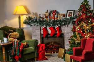 A photo of holiday home decor Christmas-themed living room, featuring green and red chairs, a fireplace, and other bright-colored holiday ornaments   Luxury homes by brittany corporation