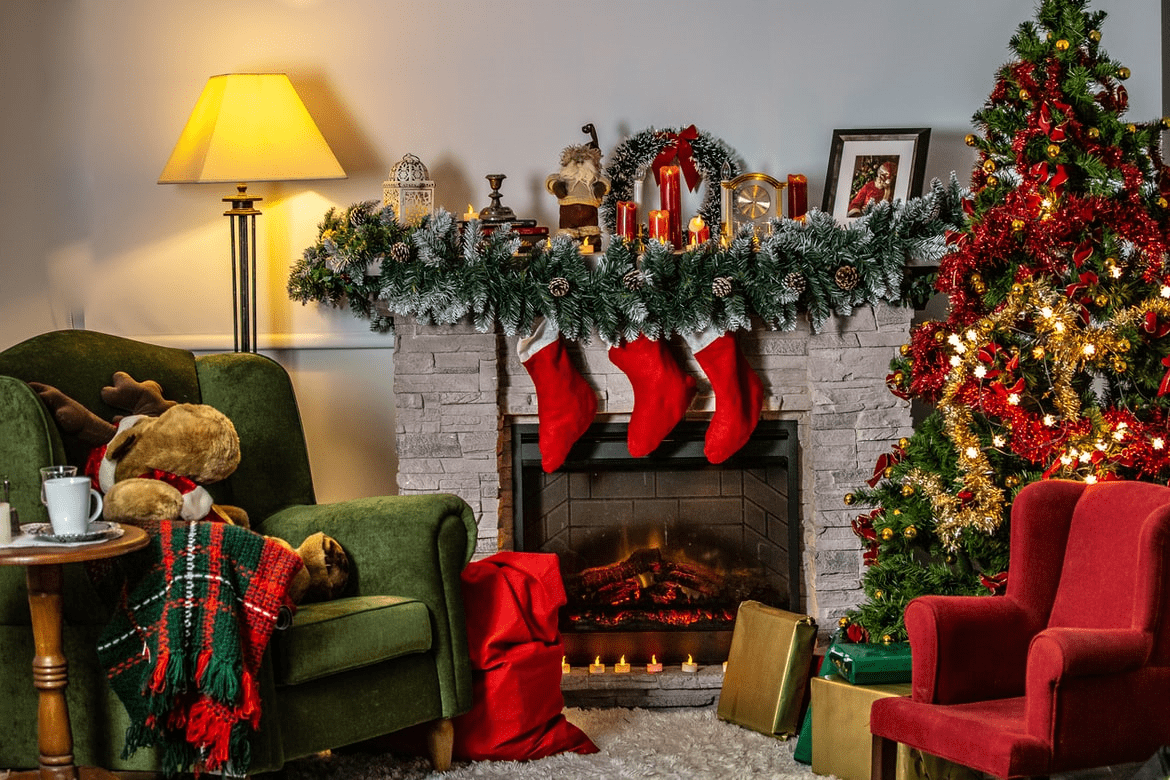 A photo of holiday home decor Christmas-themed living room, featuring green and red chairs, a fireplace, and other bright-colored holiday ornaments | Luxury homes by brittany corporation