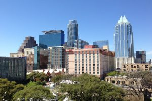 Austin Texas skyline dotted with luxury condominiums amidst the blue sky luxury houses and lots vegan travel   luxury homes by brittany corporation