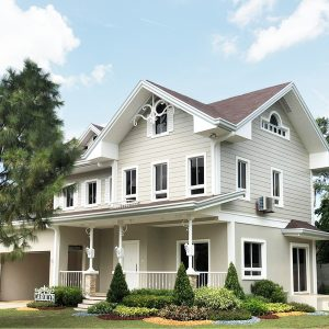 A photo of a huge multiple-storey house with light-colored paint and spacious front porch. | luxury homes by brittany corporation