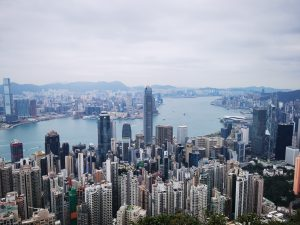 Hong Kong skyline overseeing the ocean luxury condos and luxury condominium in the background for vegan travel   luxury homes by brittany corporation