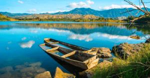 Parked boat in Lake Pantabangan in Nueva Ecija with sunset views - Brittany Corporation