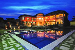 Portofino Alabang clubhouse in in front of a pool for their luxury homes   luxury homes by brittany corporation