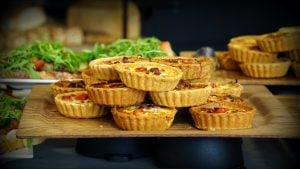 10 pieces of Quiche on a wooden table luxury mansion crosswinds tagatyay   Luxury home by brittany corporation