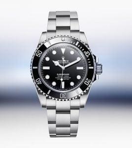 Silver and black rolex submariner line divers watch worn by homeowners of luxury house and lot in crosswinds tagaytay   luxury homes by brittany corporation