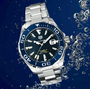 Silver and blue tag heuer watch aquarcer line under water with a blue background worn by prople that live in luxury condominiums in Crosswinds Tagaytay   luxury homes by brittany corporation