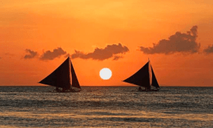 Sunset skies by the sea while riding on a boat - Brittany Corporation