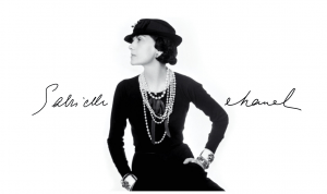 Black and white photo of Coco Chanel who pioneered one of the top luxury bag brands in the world