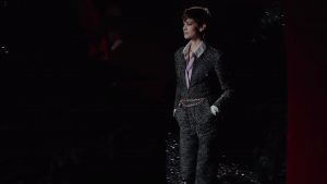 Lady with cropped hair wears a one piece suit   luxury homes by Brittany Corporation