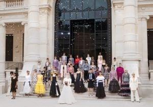 Women of different ethnicities wearing chanel luxury clothes celebrate the finale of the chanel fashion show   luxury homes by brittany corporation