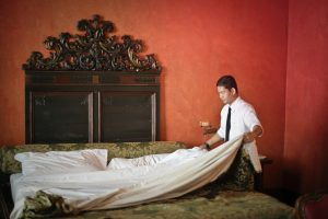 man fixing the bed   luxury homes by brittany corporation