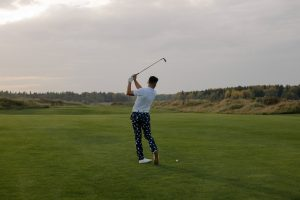 man playing golf   luxury homes by brittany corporation