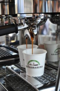 Espresso machine pouring coffee into two cups | Luxury homes by brittany corporation