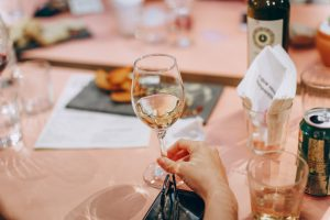 Women enjoying wine   luxury homes by brittany corporation