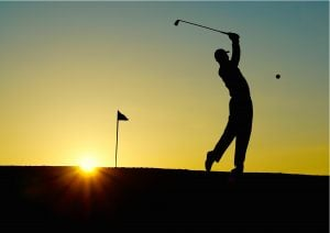 silhouette of a man playing golf. | Luxury homes by brittany corporation