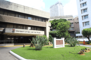 University of Asia and the Pacific facade luxury university with plants on the front lawn surrounded by buildings in Manila | Luxury homes by brittany corporation