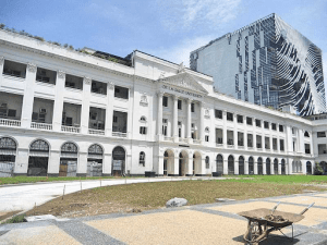 De La Salle University facade white building luxury architectural design and dead grass in front | Luxury homes by brittany corporation