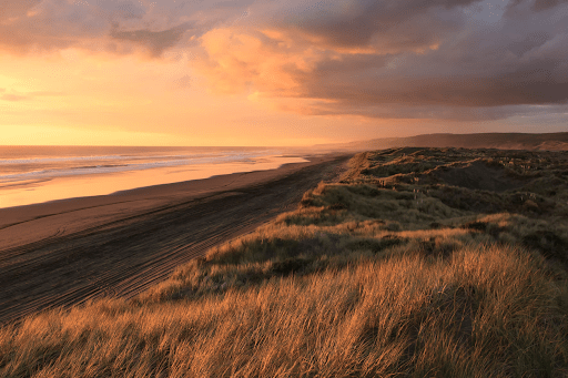 A landscape photograph of a sprawling coast during the golden hour   Luxury Homes by Brittany Corporation