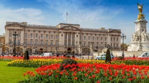 Buckingham palace most expensive homes luxury mansion with red and yellow tulips around it   Luxury homes by Brittany corporation   Luxury homes by Brittany corporation
