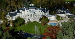 Franchuck luxury mansion surrounded by greenery trees and a fountain   Luxury homes by brittany corporation