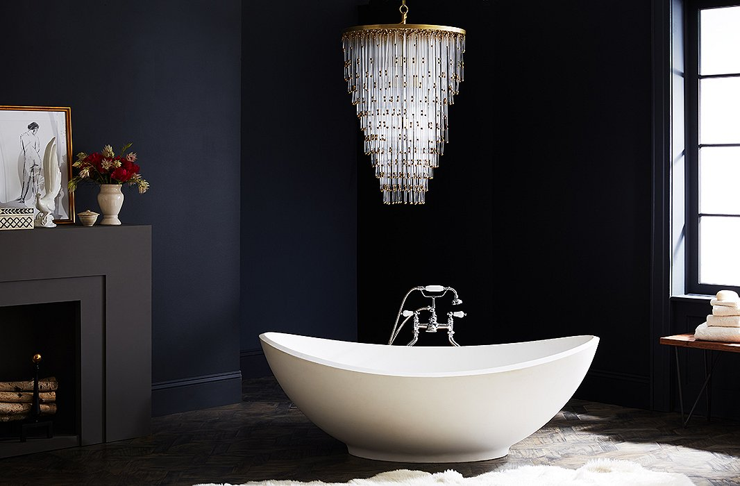 Luxury Chandelier in black-walled bathroom with big white tub in a luxury house and lot | Luxury Homes by Brittany Corporation