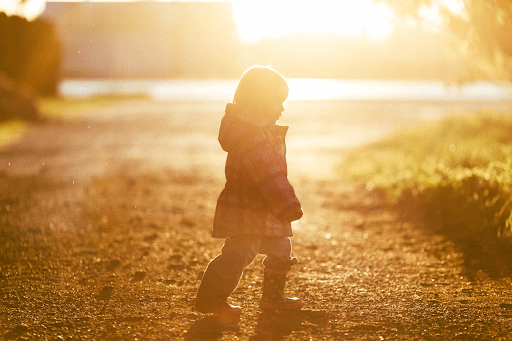 Child walking in open field   Luxury Homes by Brittany Corporation