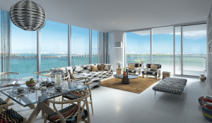 missoni baia miami luxury condominium overseeing the ocean glass table with food sofa anf curtains | Luxury homes by Brittany Corporation