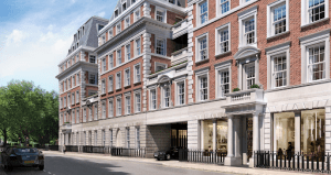 no 1 grosvenor square london luxury condominium red brick wall and stone brick wall black car below surrouded by trees | Luxury Homes by Brittany Corporation